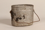 Wehrmacht M1931 mess tin placed on a workbench used to conceal a Jewish family's hiding place