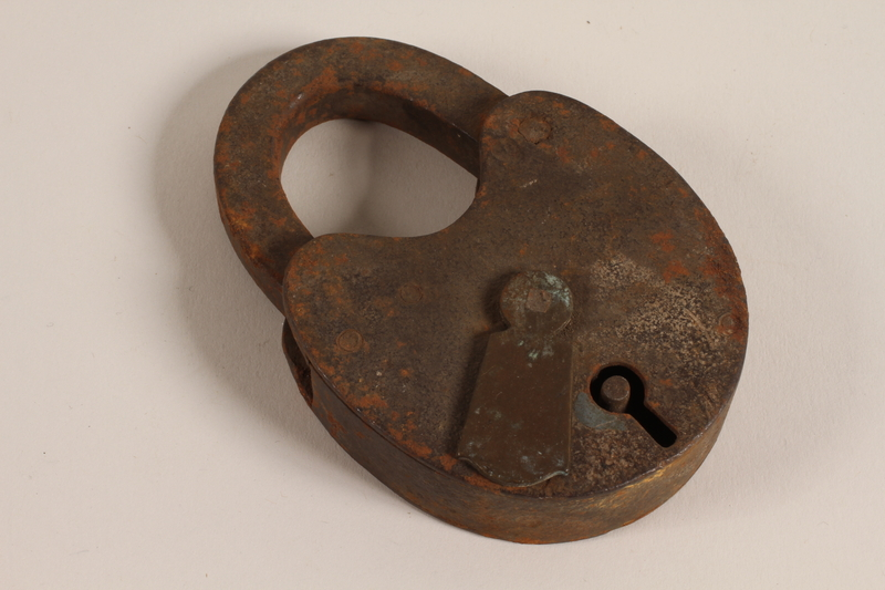 1992.240.26 front Padlock placed on a workbench used to conceal a Jewish family's hiding place
