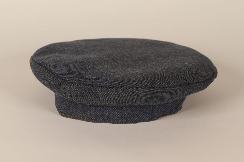 1992.36.2 front Dark blue concentration camp uniform cap worn by a Polish Jewish inmate