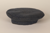 1992.36.2 front Dark blue concentration camp uniform cap worn by a Polish Jewish inmate  Click to enlarge