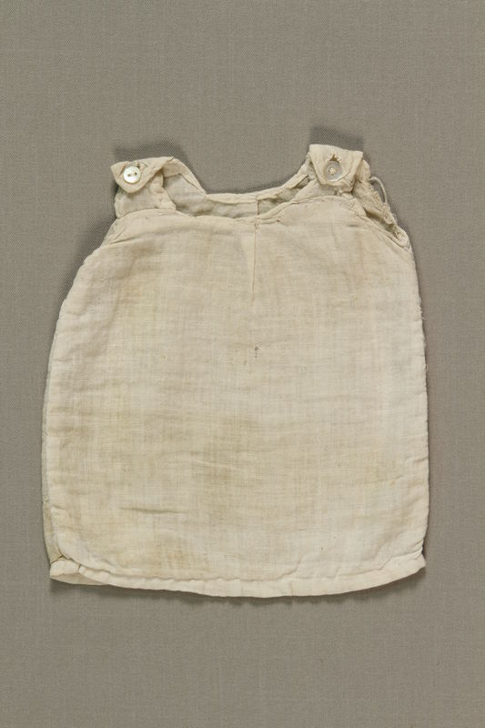 1992.4.2 front Doll's white cotton sleeveless slip given to a young girl by a friend in Theresienstadt ghetto