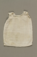 1992.4.2 front Doll's white cotton sleeveless slip given to a young girl by a friend in Theresienstadt ghetto  Click to enlarge