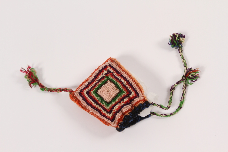 1992.4.3 front Doll's colorful crocheted tassel hat given to a young girl after her release from Theresienstadt