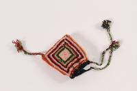 1992.4.3 front Doll's colorful crocheted tassel hat given to a young girl after her release from Theresienstadt  Click to enlarge