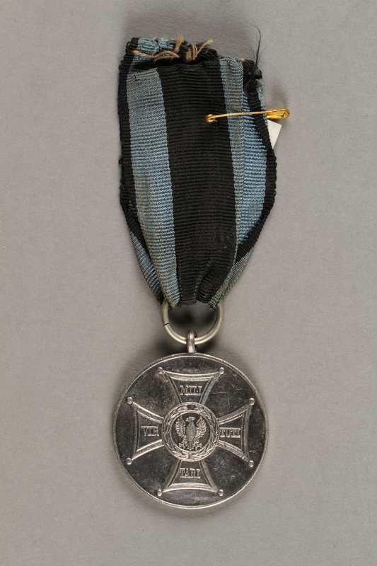 2019.21.3 front Silver Medal of Merit