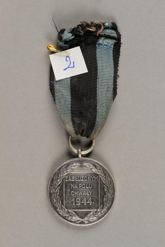 2019.21.3 back Silver Medal of Merit