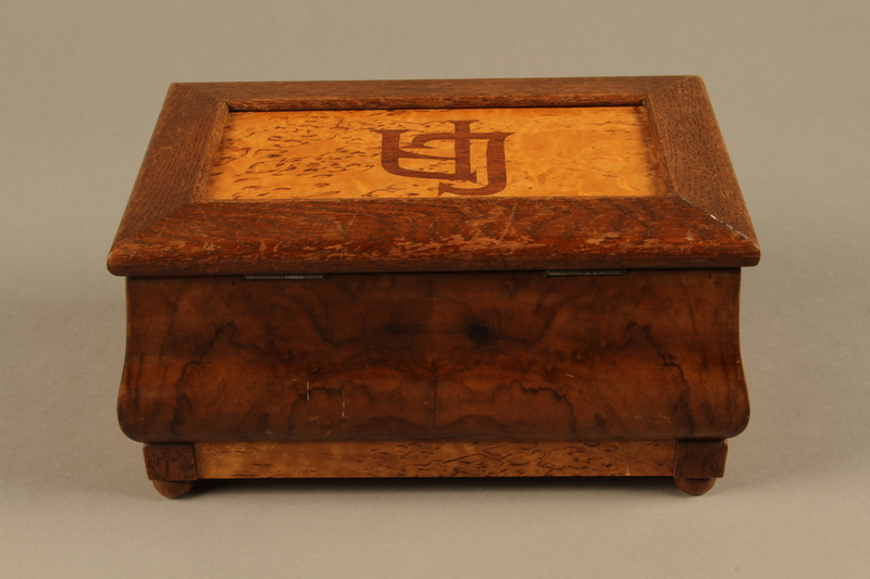 2019.180.2 a-b back Jewelry box with a secret compartment used to hide documents belonging to German Jewish prisoners
