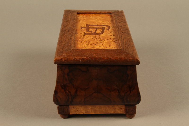 2019.180.2 a-b left Jewelry box with a secret compartment used to hide documents belonging to German Jewish prisoners