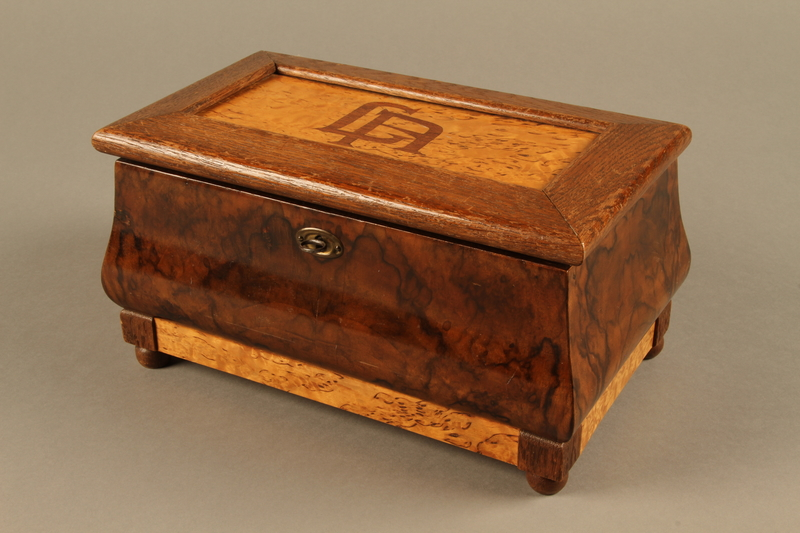 2019.180.2 a-b 3/4 view Jewelry box with a secret compartment used to hide documents belonging to German Jewish prisoners