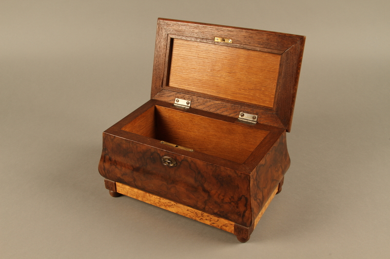 2019.180.2 a-b 3/4 open Jewelry box with a secret compartment used to hide documents belonging to German Jewish prisoners