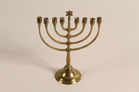 1992.54.1 front Hanukkah lamp found in rubble of Chancellery used by Hitler  Click to enlarge