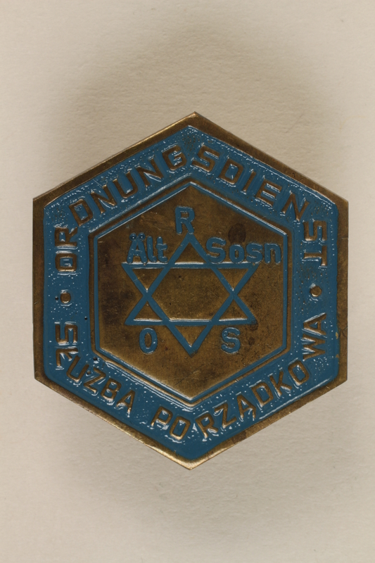 1992.58.1 front Jewish police badge from Sosnowiec, Poland