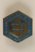 1992.58.1 front Jewish police badge from Sosnowiec, Poland  Click to enlarge