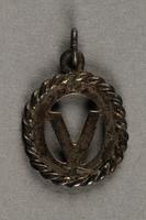 """2019.183.8 back """"V"""" pendant or charm, made by Vapniarka prisoners  Click to enlarge"""