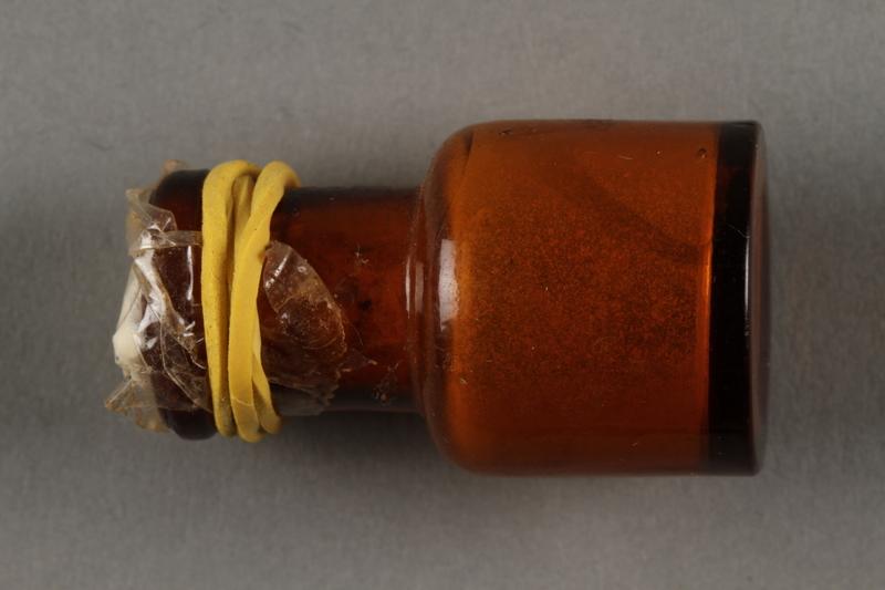 2019.183.12 side a Seed housed inside glass jar