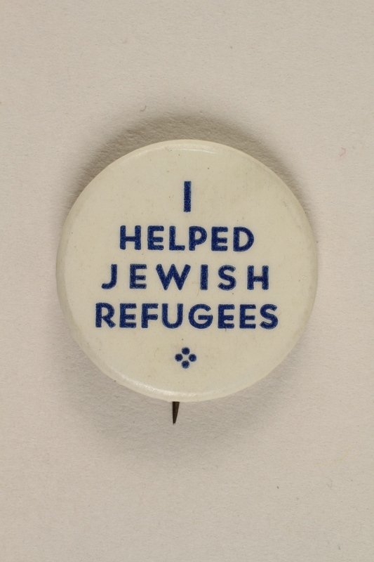 1992.68.2 front Button pin advertising humanitarian support