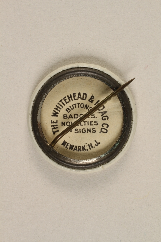 1992.68.2 back Button pin advertising humanitarian support