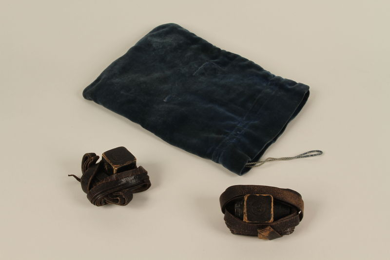 1992.8.18_a-c front Pair of tefillin with blue velvet bag used by a Jewish refugee