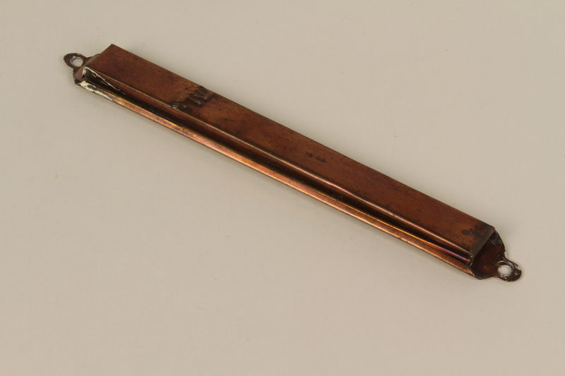 1992.8.26 front Mezuzah in a copper metal case used by a Jewish refugee family