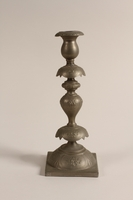1992.8.28 a front Pair of Sabbath candlesticks with wax reservoirs owned by a Jewish refugee  Click to enlarge