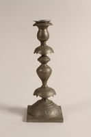 1992.8.28 a-b front Pair of Sabbath candlesticks with wax reservoirs owned by a Jewish refugee  Click to enlarge