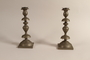 Pair of Sabbath candlesticks with wax reservoirs owned by a Jewish refugee