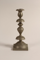 1992.8.28 c front Pair of Sabbath candlesticks with wax reservoirs owned by a Jewish refugee  Click to enlarge