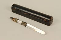 1992.8.30_a-b front Circumcision knife with a glass and metal handle with a black wooden case used by a mohel  Click to enlarge