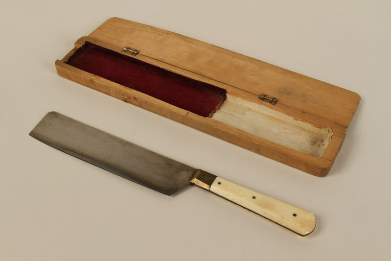 1992.8.33_a-b front Ritual slaughter knife with a wooden case used by a shochet