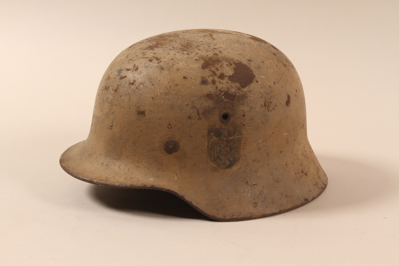 1992.85.1 left side German army helmet found by a US soldier