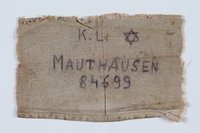 1992.93.2 front Badge issued at Mauthausen concentration camp  Click to enlarge
