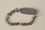 Chain link bracelet with ID tag engraved with prisoner number