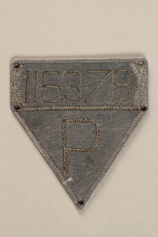 1992.98.1 front Replacement ID tag created in an airplane factory