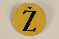 1993.113.1 front Yellow metal badge with a brown Croatian letter Z to identify a Jew  Click to enlarge
