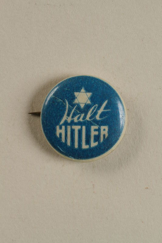 1993.116.1 front Halt Hitler blue and white ant-Nazi propaganda pin with a Star of David