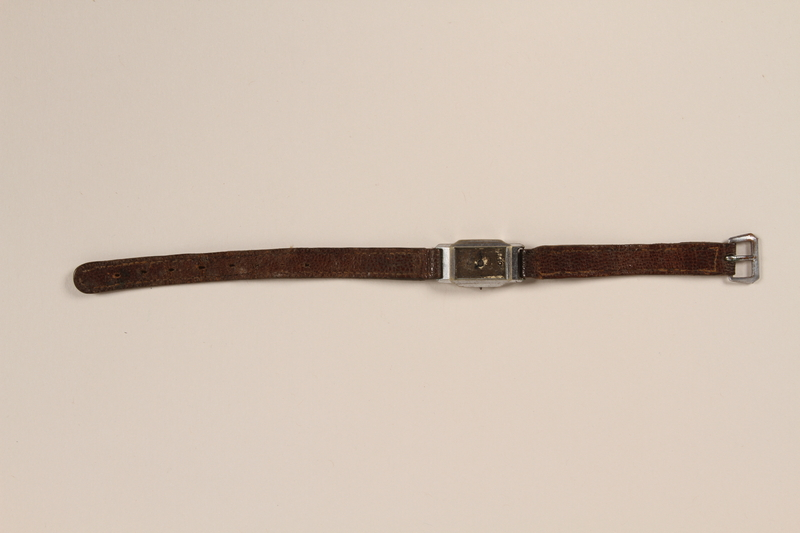1993.118.1 front Wrist watch with a brown leather strap removed from Sobibor
