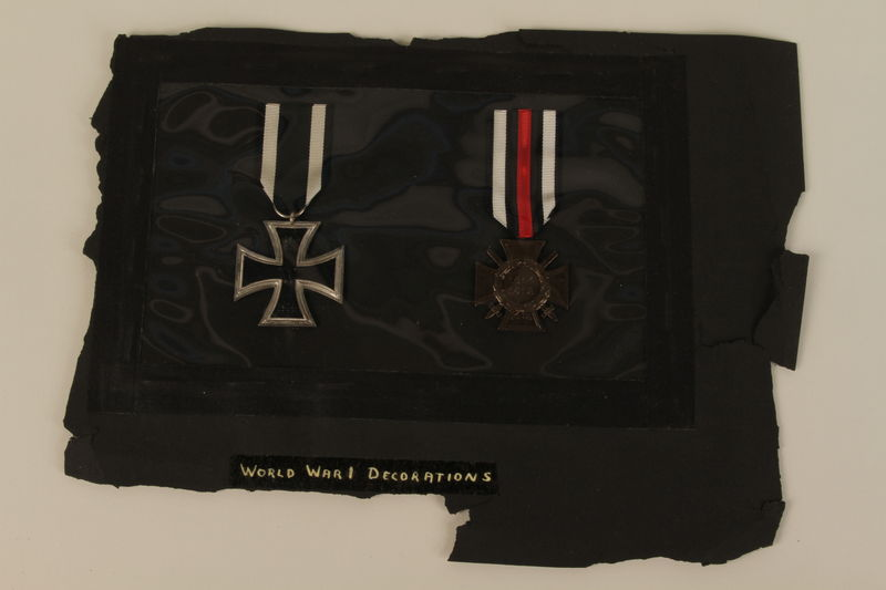 1993.125.1_b-c front WWI Hindenburg Cross medal with attached red, white, and black ribbon