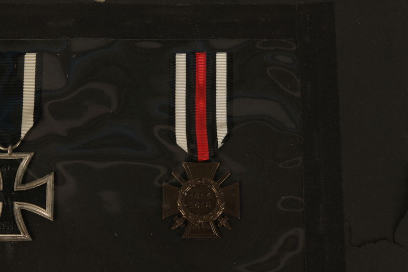 1993.125.1_c front WWI Hindenburg Cross medal with attached red, white, and black ribbon