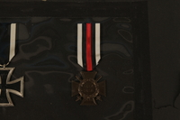 1993.125.1_c front WWI Hindenburg Cross medal with attached red, white, and black ribbon  Click to enlarge