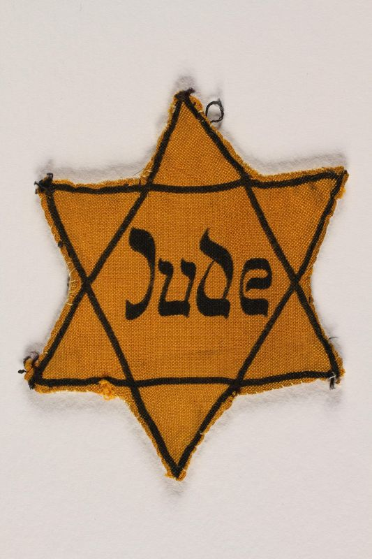 1993.125.2 front Star of David badge with Jude printed in the center