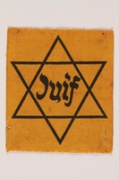 1993.14.1 front Star of David badge with Juif printed in the center  Click to enlarge