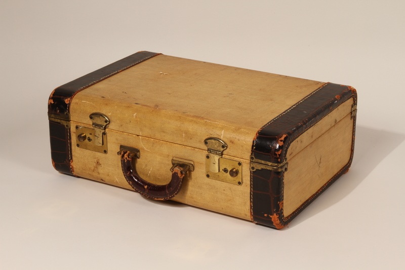 2012.454.2 front Small yellow suitcase used by a young German Jewish girl on the Kindertransport