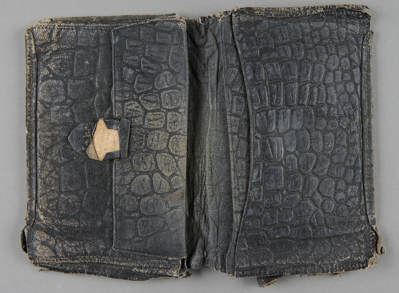 2013.178.5 open Patterned black leather wallet used by a Polish Jewish refugee