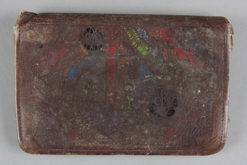2013.178.6 front Leather wallet with a painted geometric design used by a Polish Jewish refugee