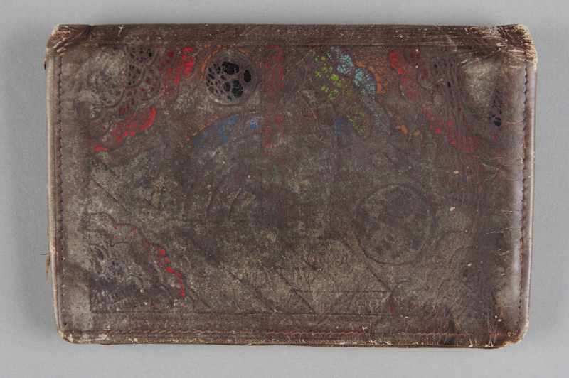 2013.178.6 back Leather wallet with a painted geometric design used by a Polish Jewish refugee