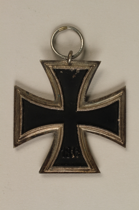 1993.151.2_a back WWII Iron Cross 2nd Class medal taken from the body of a dead German soldier by an American soldier