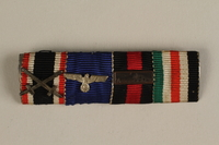 1993.151.2_b front WWII Iron Cross 2nd Class medal taken from the body of a dead German soldier by an American soldier  Click to enlarge