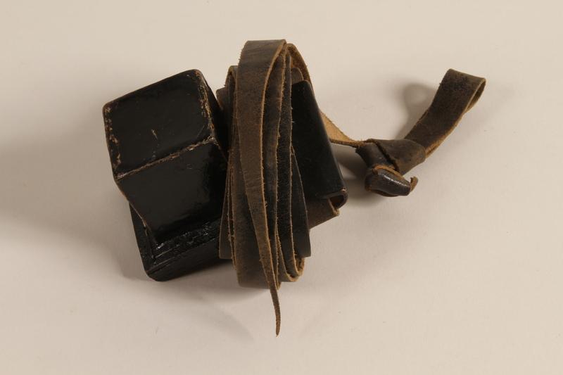 1993.156.1.2 a-b front Hand tefillin worn by a Polish Jewish man