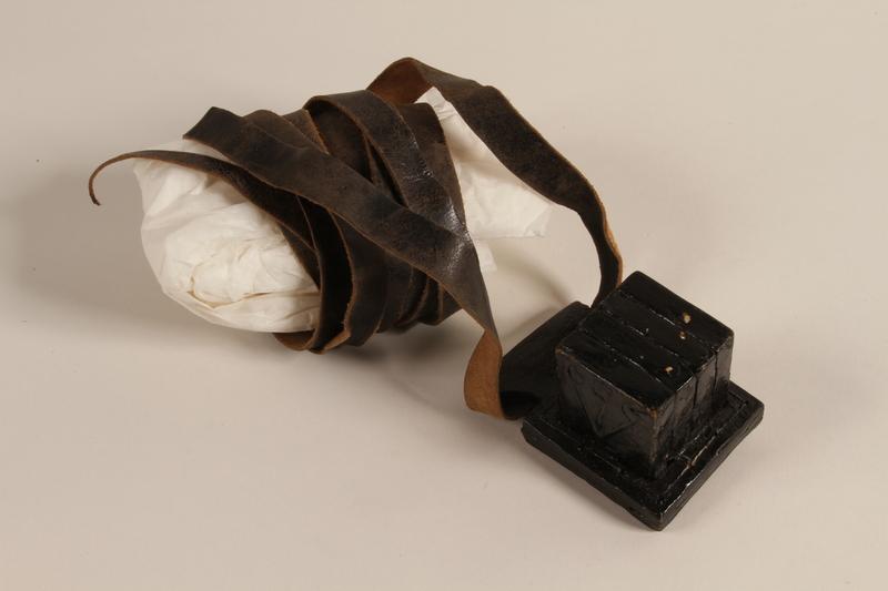 1993.156.1.3 a-b front Head tefillin worn by a Polish Jewish man