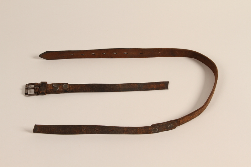 1993.156.2_a-b front Brown leather belt secretly made by a Polish Jewish concentration camp inmate